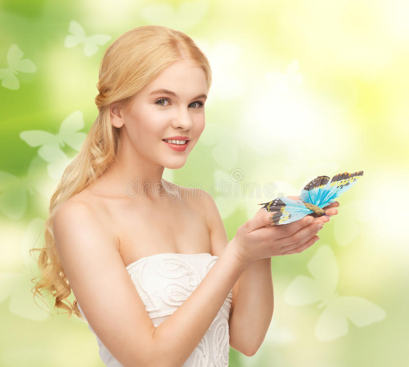 Woman with butterfly in hand stock image