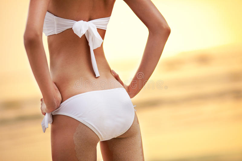 Woman buttocks on tropical beach royalty free stock image