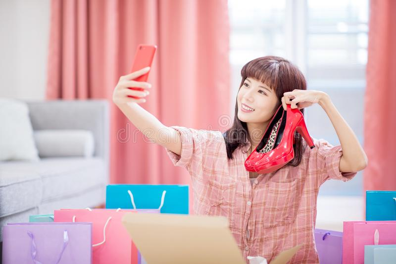 Woman buy shoes on internet royalty free stock photography