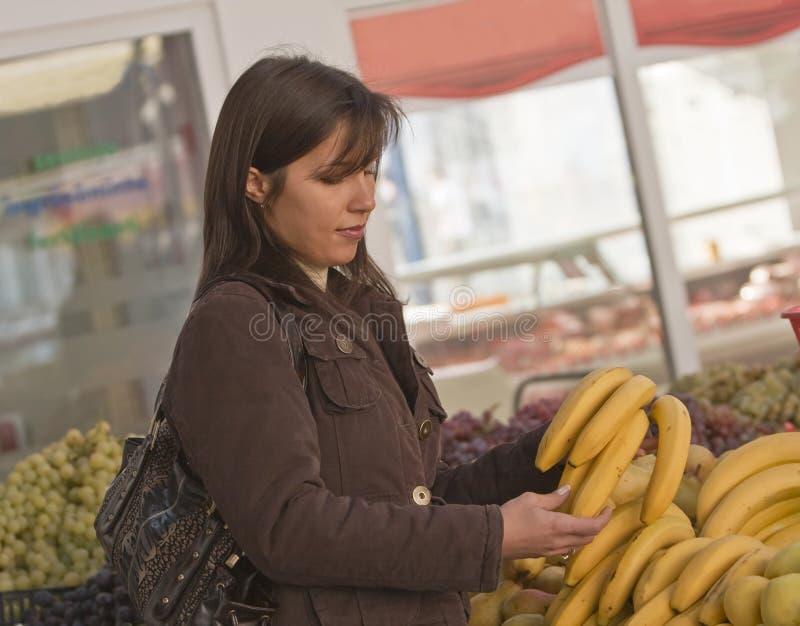 Woman buying banans stock photos