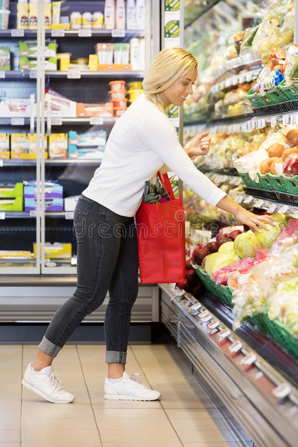 Woman Buying Cabbage In Supermarket royalty free stock photo