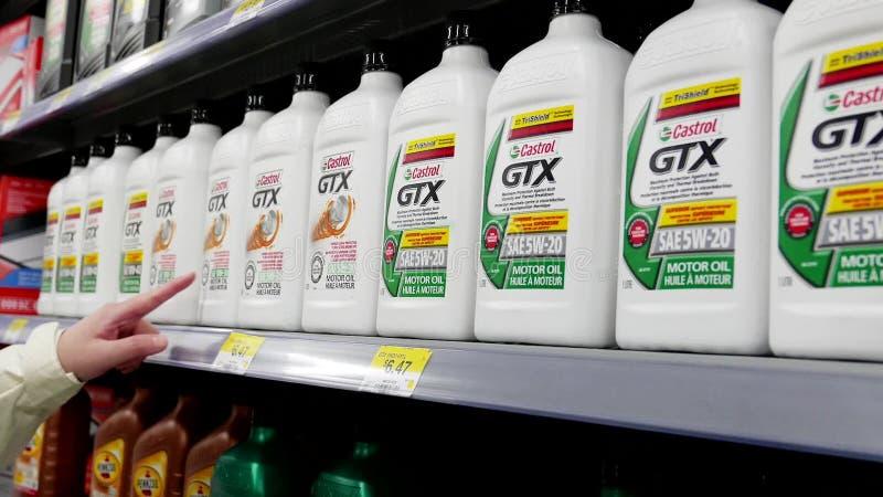 Woman buying Castrol gtx motor oil