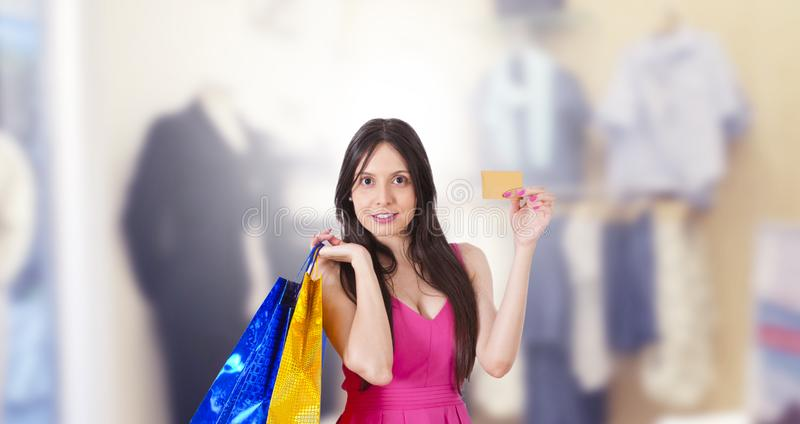 Woman buying with credit card royalty free stock photo