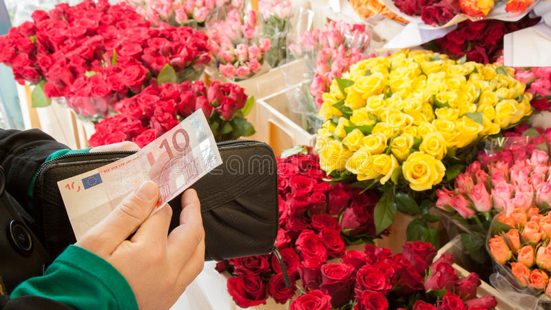 Download A woman buying flowers stock image. Image of pink, multicolored - 26357999