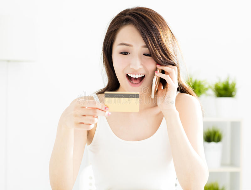 Woman buying online with credit card. And smart phone stock photos