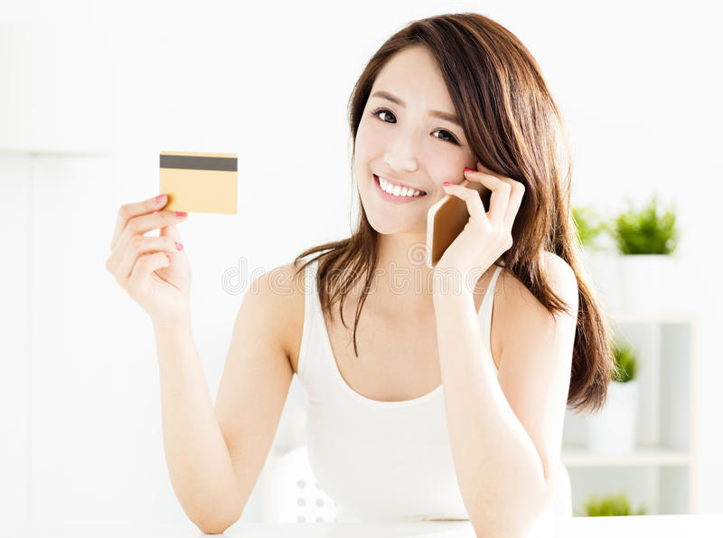 Woman buying online with credit card. And smart phone stock image