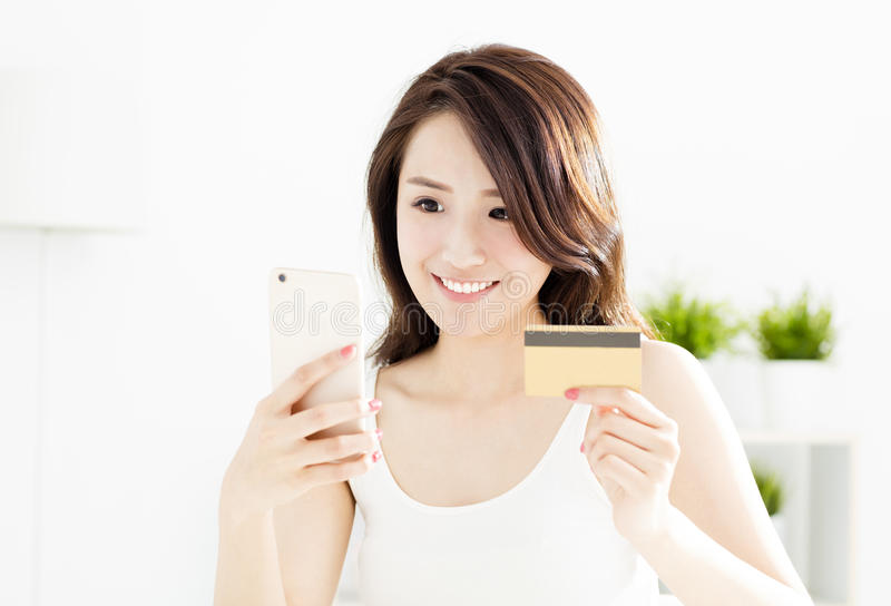 Woman buying online with credit card. And smart phone royalty free stock photo