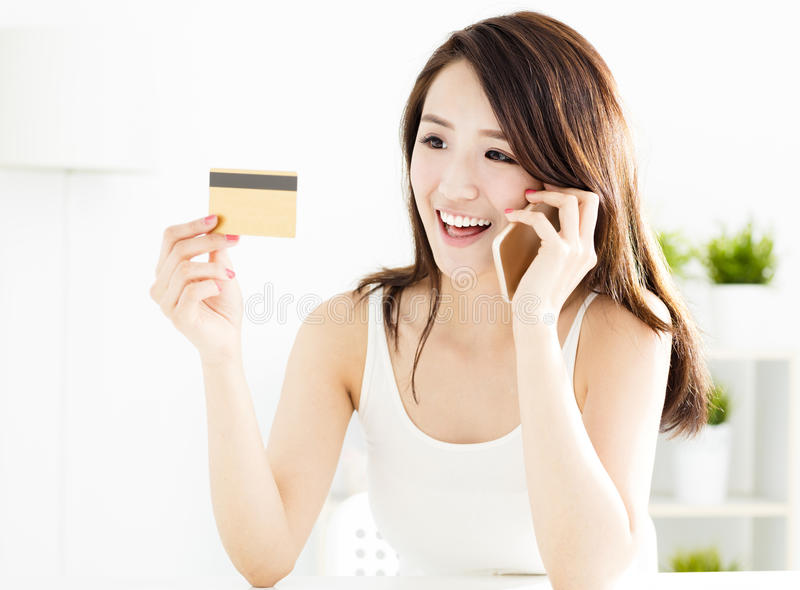 Woman buying online with credit card. And smart phone royalty free stock images