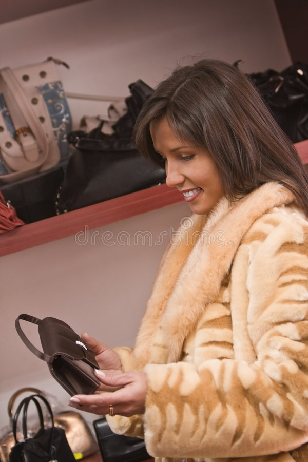 Download Woman buying purse stock photo. Image of woman, store - 3455056