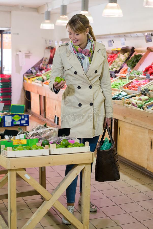 Woman buyingfruits in supermarket. Woman stock photos