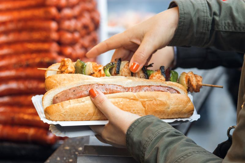 Woman buys meal at Christmas street food market stock photos