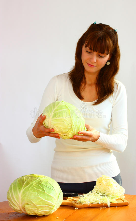 Woman and cabbage royalty free stock photo