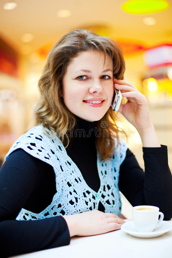 Download Woman in the cafe stock photo. Image of cellphone, comfortable - 18116412