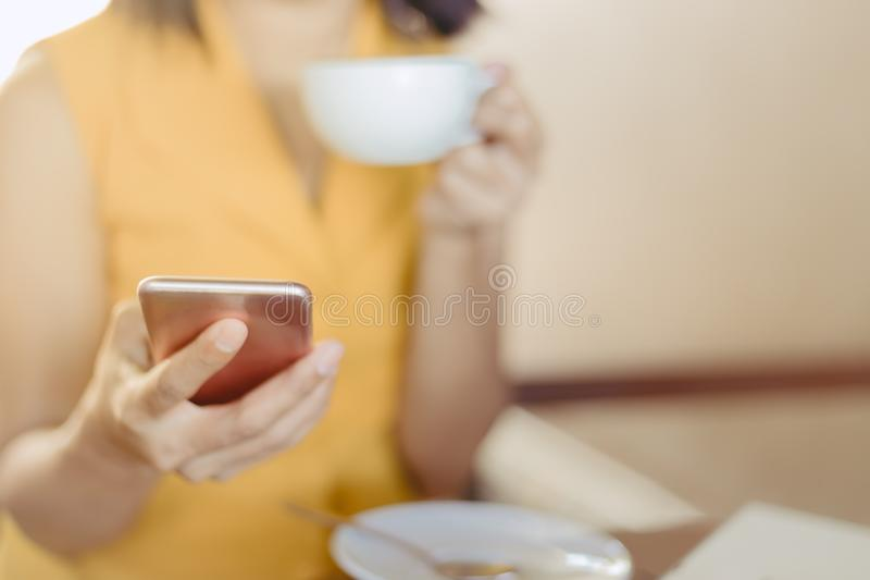 Woman at cafe drinking coffee and power full for business in the day stock photo