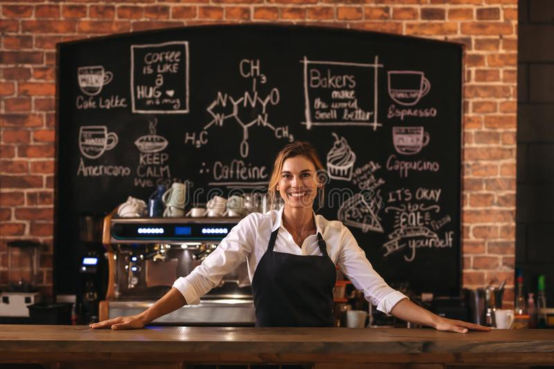 Woman cafe owner stock photo
