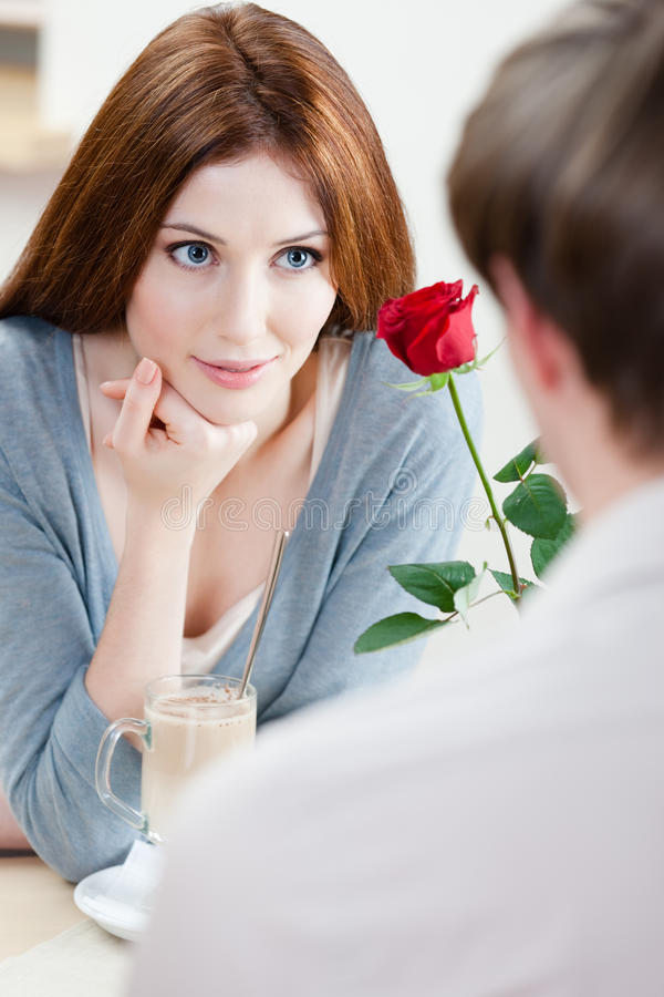 Download Woman At The Cafe With Scarlet Rose Stock Photo - Image: 28592774