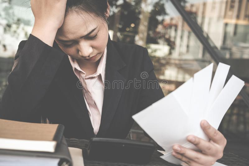 woman calculate domestic bills at home. Businesswoman using calculator at modern office. Young female checking balance & costs. royalty free stock photo