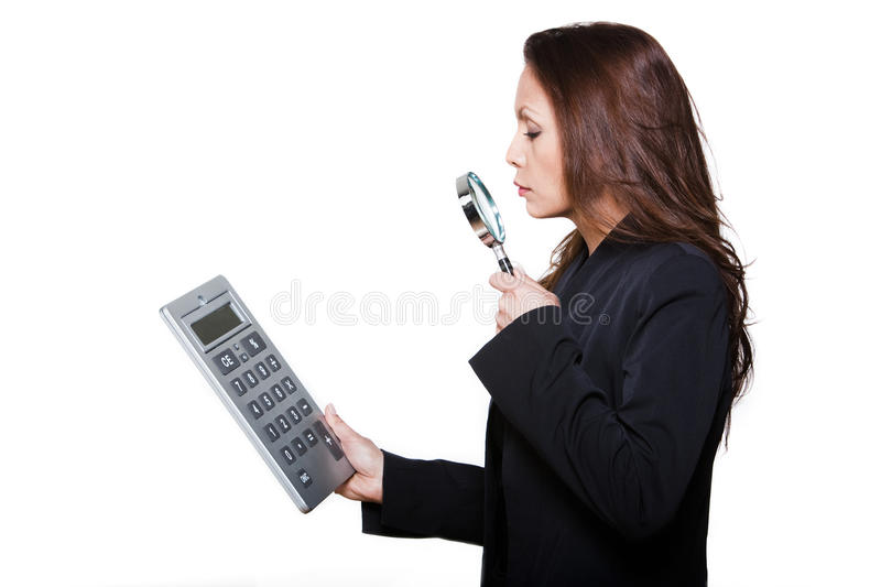 Woman calculator magnifying glass. Portrait of woman with large calculator and magnifying glass in studio isolated on white background stock photos