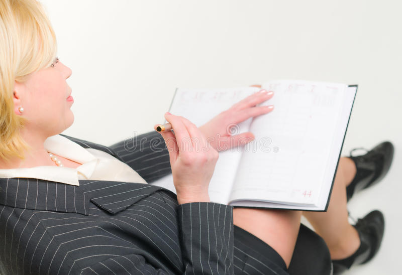Woman and calendar stock image