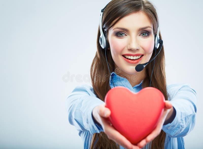 Woman call center operator hold love symbol Red heart. Close up. Business woman portrait stock photo