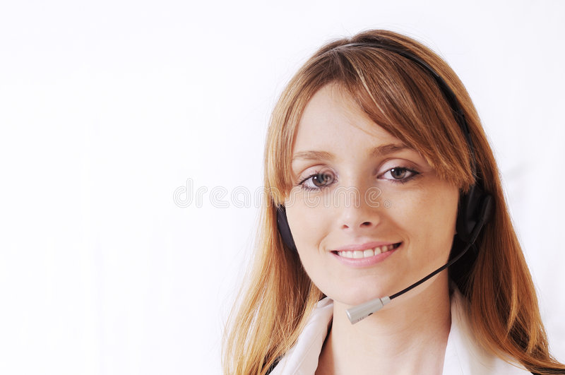 Woman and call centre. Smiling and look in camera royalty free stock photography