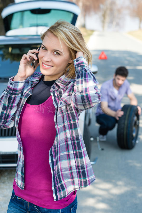 Download Woman Calling For Car Assistance Change Wheel Stock Image - Image: 24310715