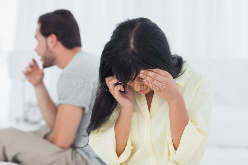 Woman calling and crying during dispute stock images
