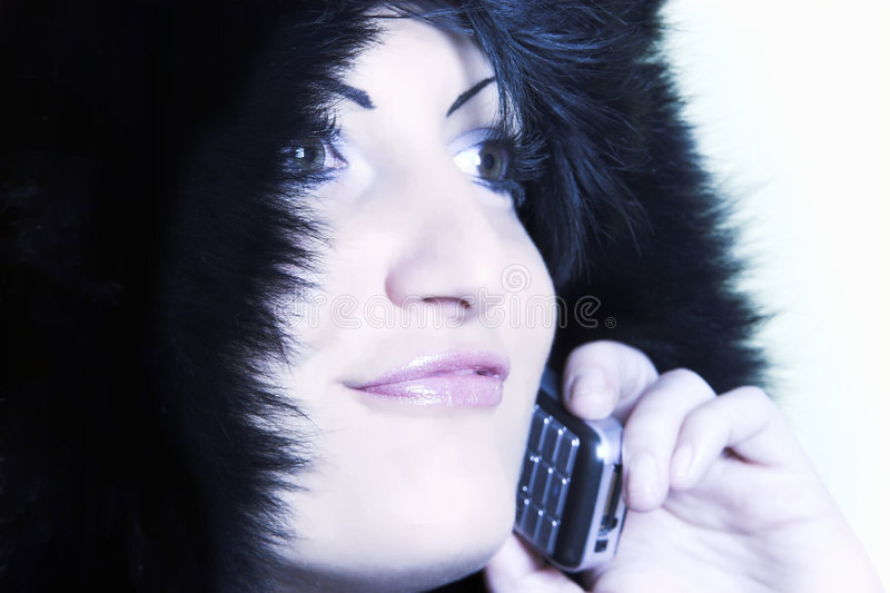 Woman calling by mobile phone stock photography
