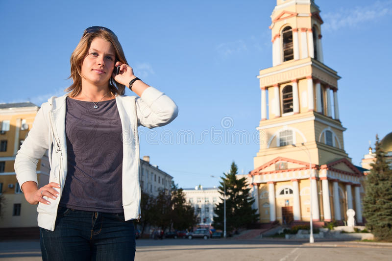 Woman calling by phone royalty free stock image
