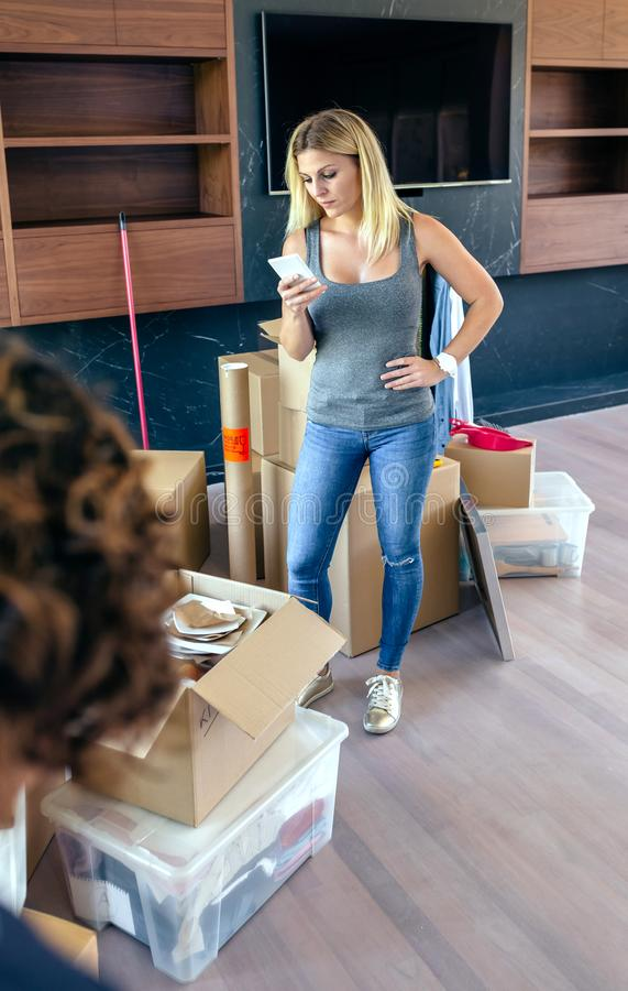 Woman calling on the phone while make a move. Woman calling on the phone while she and her husband make a move royalty free stock photography
