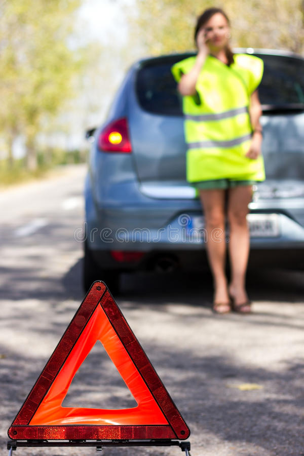 Download Woman Calls To A Service Standing By A White Car Stock Photo - Image: 26594532