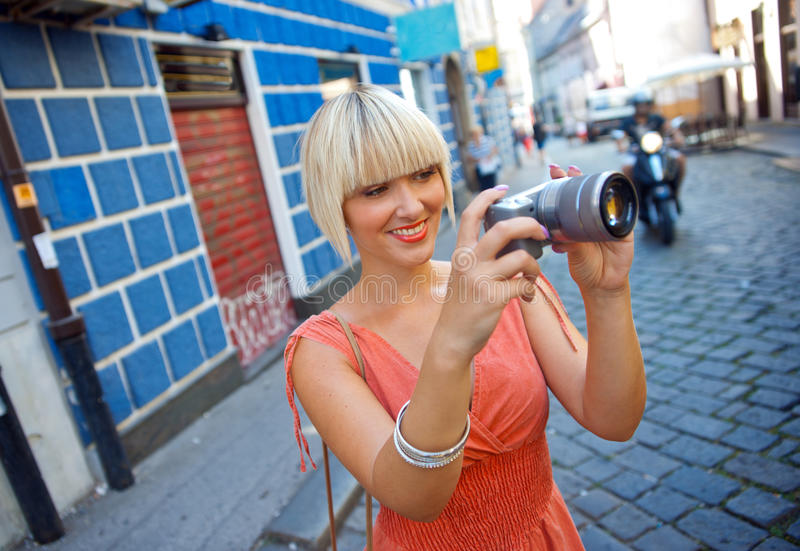 Download Woman with camera stock photo. Image of beautiful, city - 26557790