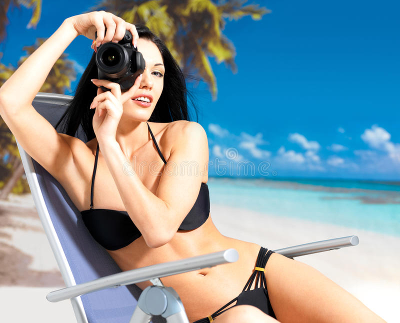 Download Woman With A Camera Taking Photos On Beach Royalty Free Stock Photography - Image: 28773857