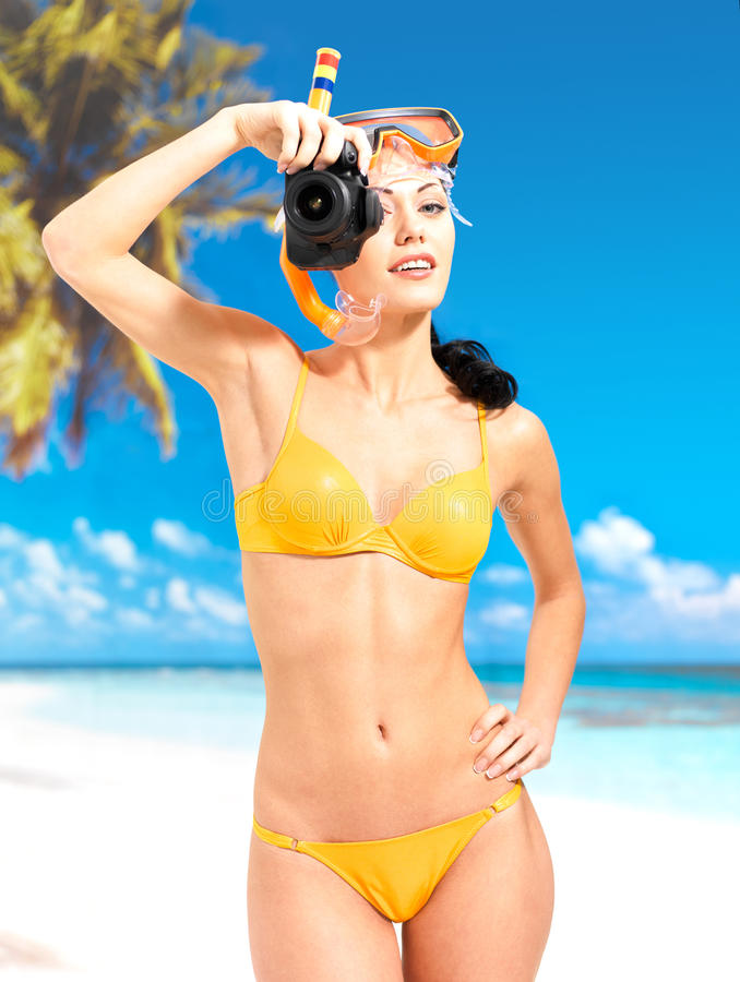 Woman With A Camera Taking Photos On Beach Stock Image