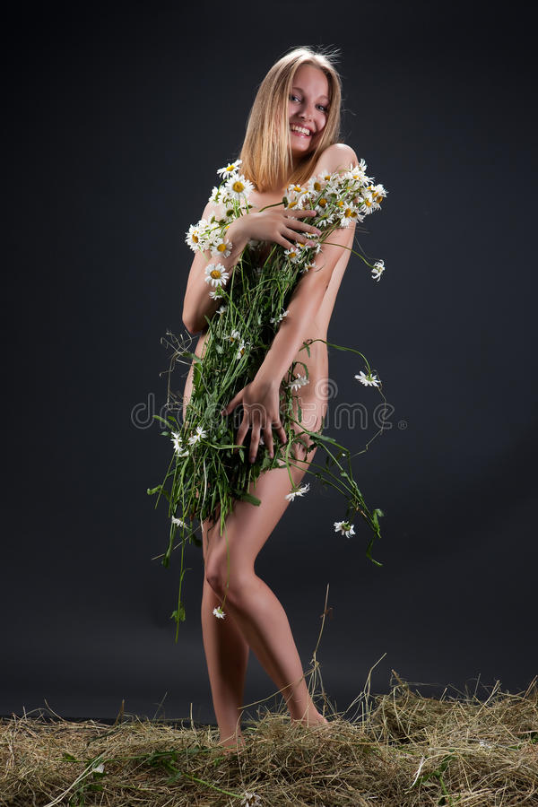 Woman With Camomiles stock photos