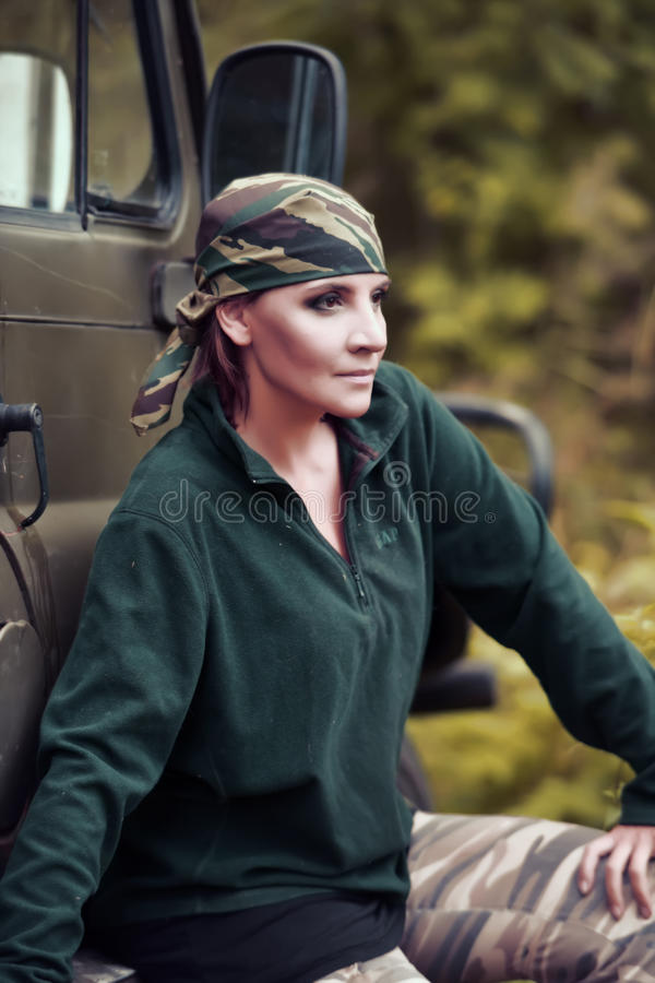 Woman in camouflage bandana. Coloring royalty free stock photo