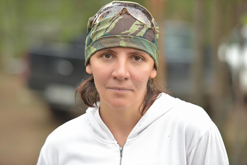 Woman in camouflage bandana. Coloring stock photography