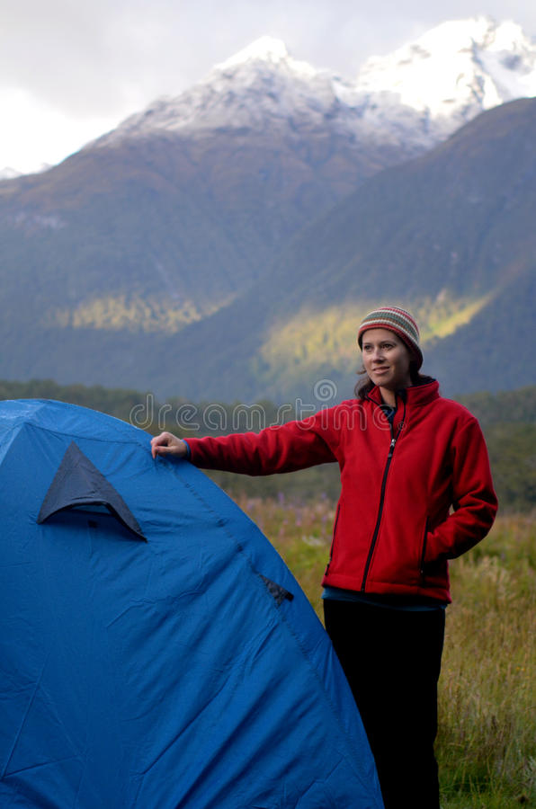 Woman camping outdoors stock image
