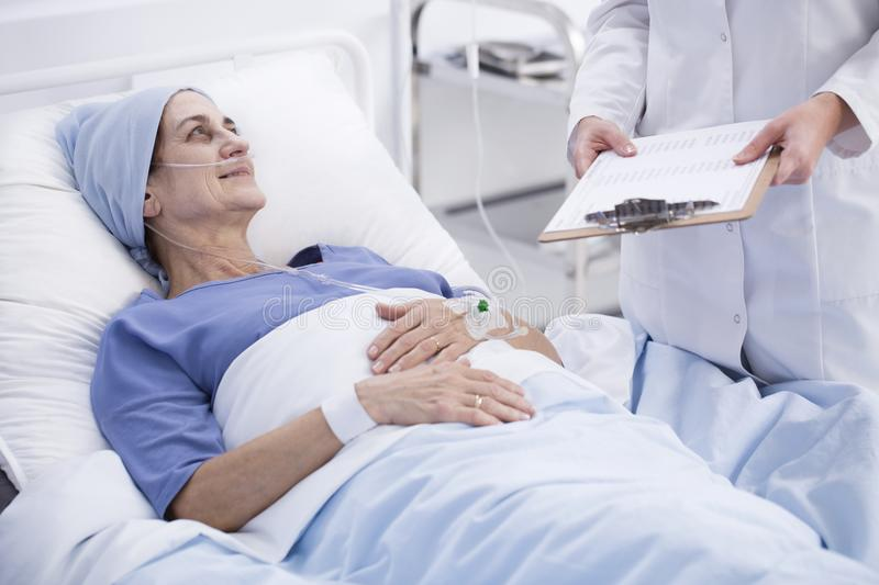 Woman with cancer and doctor stock images