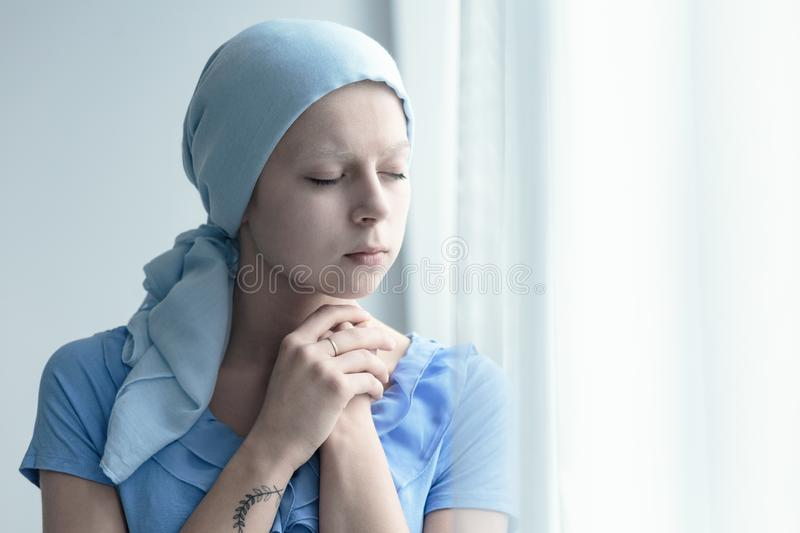 Woman with cancer praying royalty free stock photo