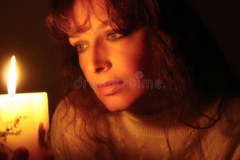 Woman and candlelight stock photos