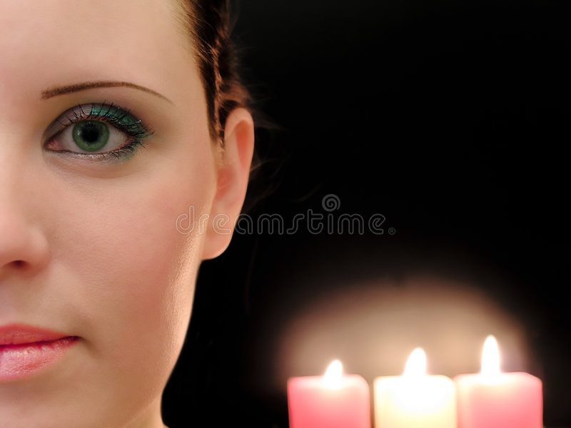 Woman and candles stock photos