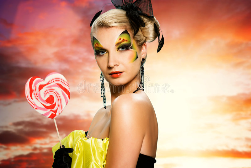 Woman with candy. Beautiful young woman with candy royalty free stock photo