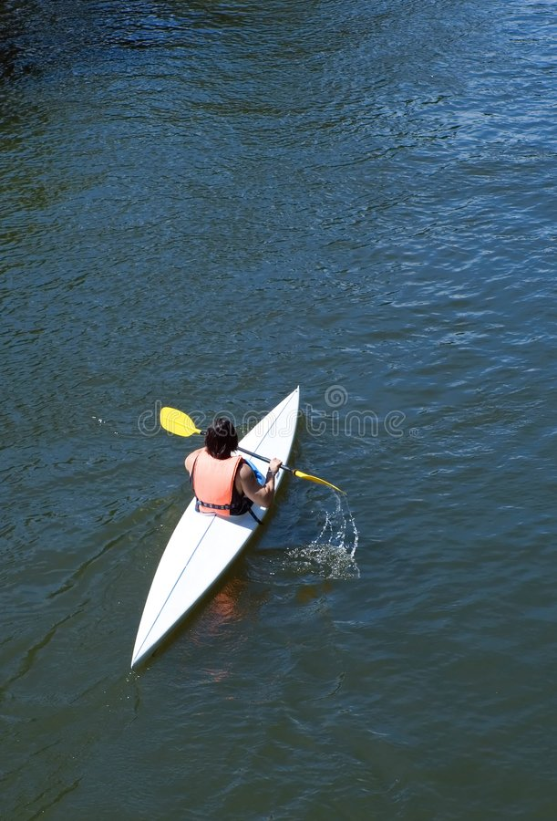 Woman in canoe royalty free stock image