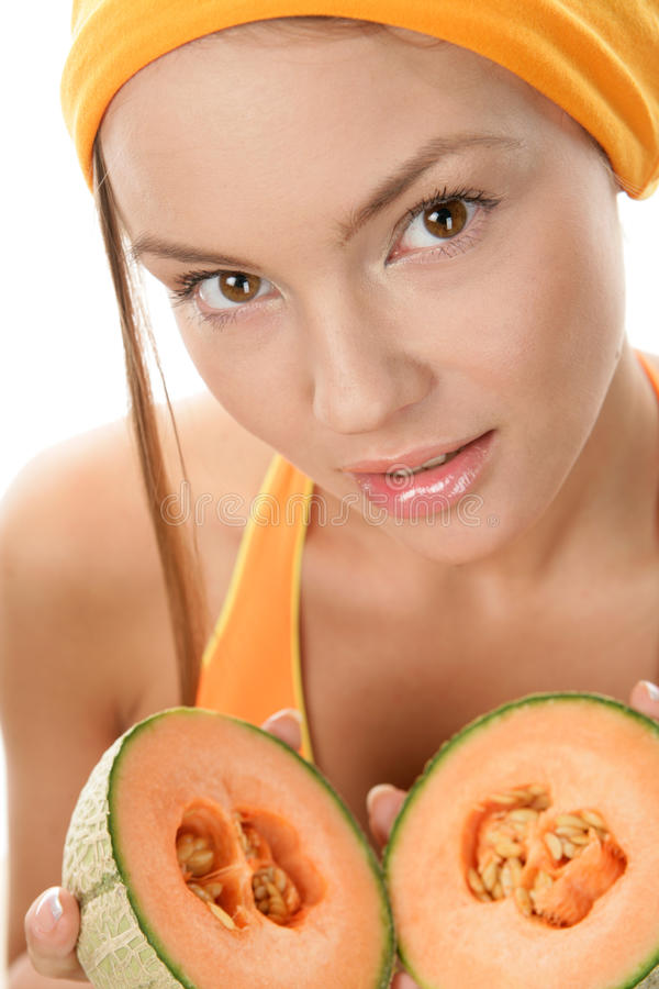 Woman with cantaloupe royalty free stock images