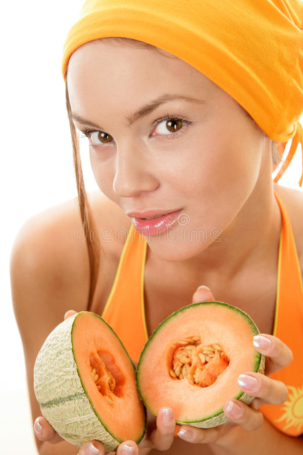 Woman with cantaloupe royalty free stock image