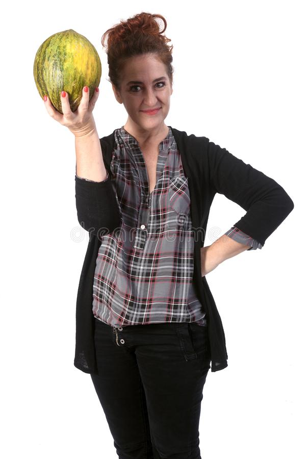 Woman with cantaloupe on white background.  royalty free stock photos