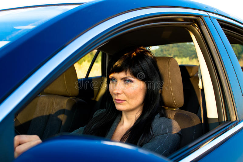 Woman in the car royalty free stock images
