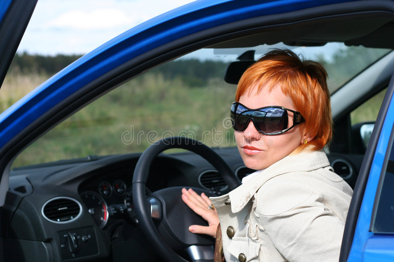 Woman and a car royalty free stock photo