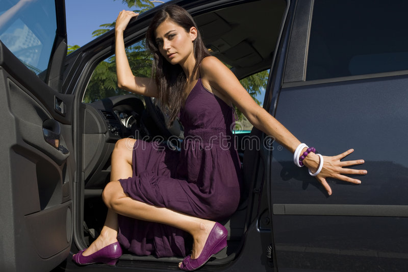 Woman on car stock photography